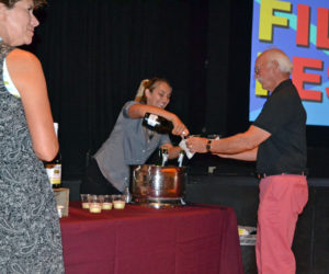 Laurel Gallione (center) serves an attendee at the opening-night reception of the inaugural MidCoast Film Fest on the evening of Friday, July 26. (Christine LaPado-Breglia photo)