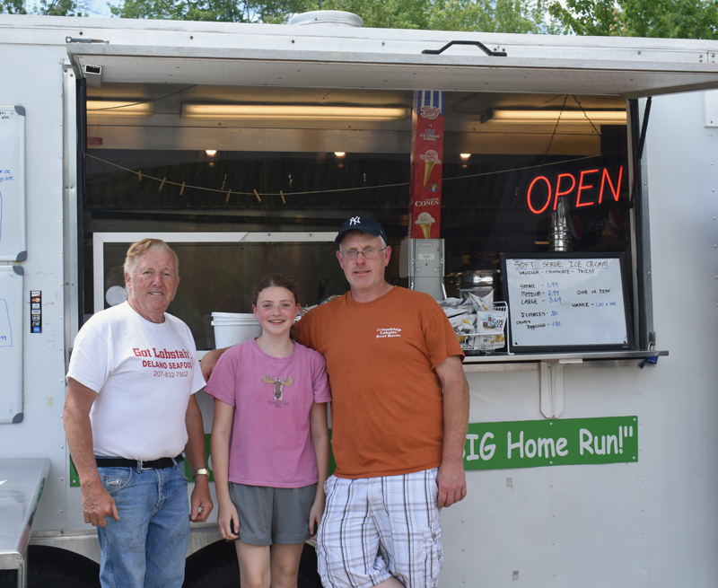 From left: Kendall Delano Sr., Dakota Brackett, and Kendall Delano Jr. at the Delano Seafood Shack in Waldoboro. (Alexander Violo photo)