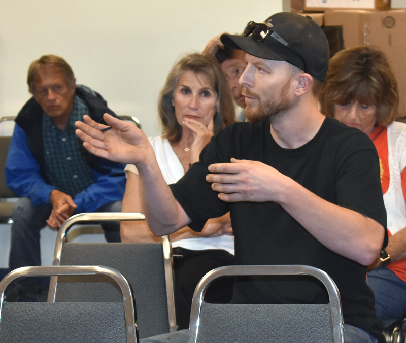 John Grotton, resource and production manager at Atlantic Laboratories Inc., of Waldoboro, speaks during a public hearing on improvements to the Dutch Neck landing Monday, July 22. (Alexander Violo photo)