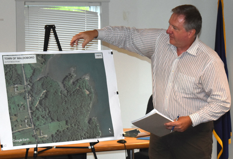 William Lane, vice president of Gartley & Dorsky Engineering & Surveying Inc., discusses proposed improvements to the Dutch Neck landing during a public hearing in Waldoboro on Monday, July 22. (Alexander Violo photo)