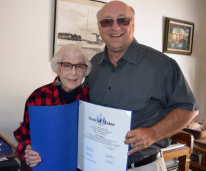 "State Sen. Dana Dow presents May Davidson a legislative sentiment at her Whitefield home on Thursday, July 25 in honor of her recent 90th birthday and her new book, ""Whatever It Takes: Seven Decades of True Love, Hard Work, and No Regrets,"" published by Islandport Press. (Christine LaPado-Breglia photo)"