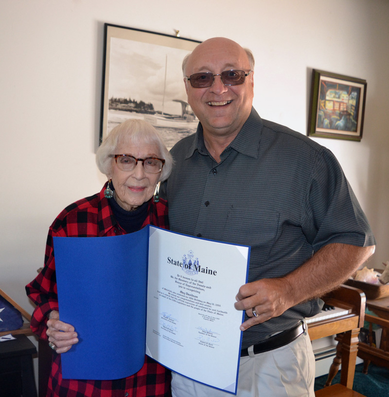 """State Sen. Dana Dow presents May Davidson a legislative sentiment at her Whitefield home on Thursday, July 25 in honor of her recent 90th birthday and her new book, """"Whatever It Takes: Seven Decades of True Love, Hard Work, and No Regrets,"""" published by Islandport Press. (Christine LaPado-Breglia photo)"""
