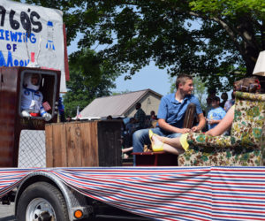 A float celebrates the 50th anniversary of the 1969 moon landing during the Fourth of July parade in Whitefield. The float depicts people in period dress watching the event on TV. (Jessica Clifford photo)