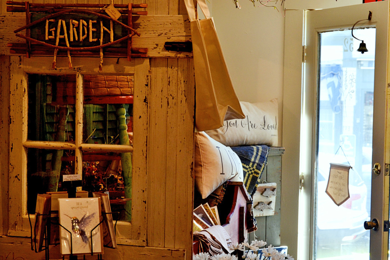 The original barn door from the Old and Everlasting shop in Cazenovia, N.Y. serves as a prop for merchandise in the Wiscasset shop. (Nettie Hoagland photo)