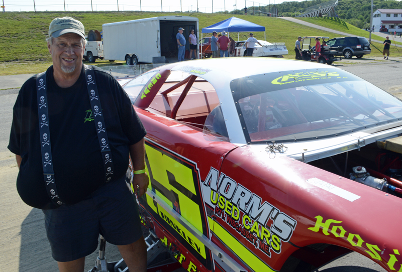 Harold Hinkley, longtime car owner and a member of the first class to enter the Wiscasset Speedway Hall of Fame, stands next to his #15 prostock car in the pits at the Wiscasset Speedway 50th anniversary event Saturday, July 27. His son, Nick Hinkley, drives the car. (Evan Houk photo)