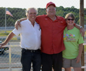 """Wiscasset Speedway owners Richard and Vanessa Jordan stand with former track owner Dave """"Boss Hogg"""" St. Clair (center), during his induction into the Wiscasset Speedway Hall of Fame, Saturday, July 27. (Evan Houk photo)"""