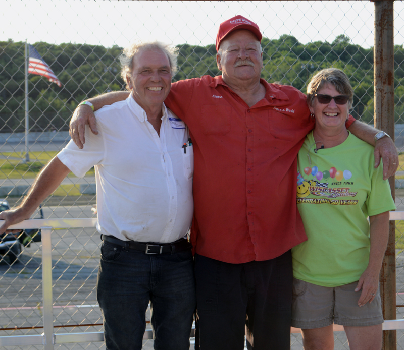 "Wiscasset Speedway owners Richard and Vanessa Jordan stand with former track owner Dave ""Boss Hogg"" St. Clair (center), during his induction into the Wiscasset Speedway Hall of Fame, Saturday, July 27. (Evan Houk photo)"