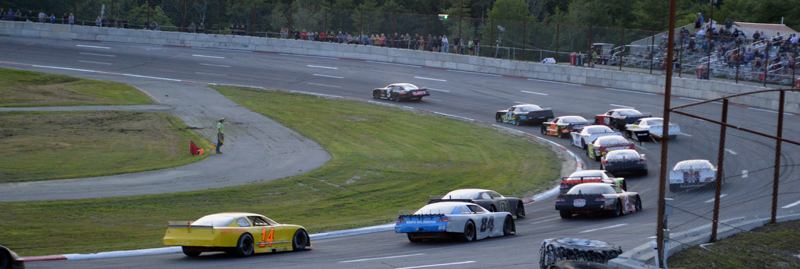 Drivers take a hard turn in the 50-lap prostock feature race during Wiscasset Speedway's 50th anniversary event Saturday, July 27. Kevin Douglass, of Sidney, won the race. (Evan Houk photo)