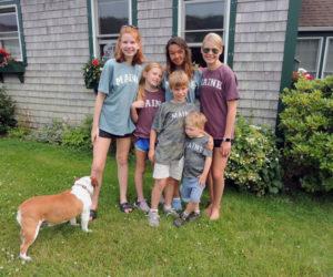 The Sawyer grandchildren with their treasurer, Bella the bulldog.