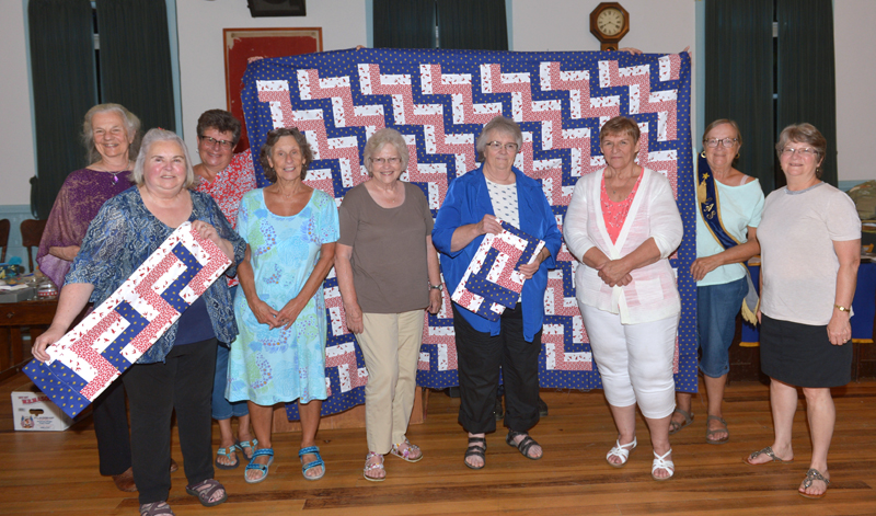 Willow Grange in Jefferson presents Lincoln County Quilters with a Spirit of America Award for their Quilts of Gratitude project. Willow Grange presented Lincoln County Quilters with a quilt top for their project. Seven members of the quilting group were on hand to receive the award. Also pictured (holding the quilt top) are Grange members Karen McCarrick and Linda Cunningham. (Paula Roberts photo)