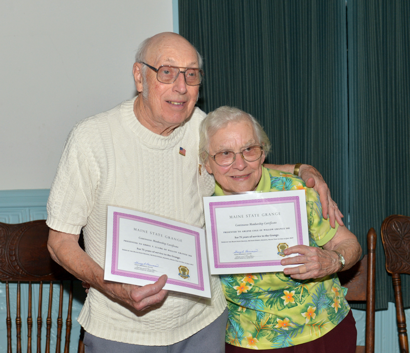 Errol T. Clark and Arlene Cole are presented 75-year certificates for continuous membership at Willow Grange on Thursday, July 25. (Paula Roberts photo)