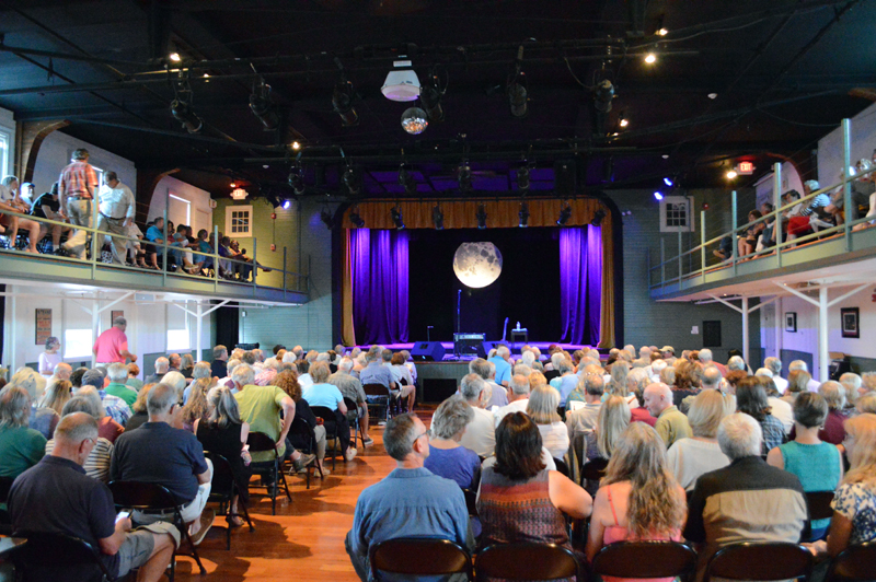A packed house waits for John Sebastian to take the stage at 7:30 p.m. on Thursday, July 25 at the Opera House at Boothbay Harbor. Sebastian interspersed all his songs with various stories from his 50-plus years in the music industry. (Evan Houk photo)