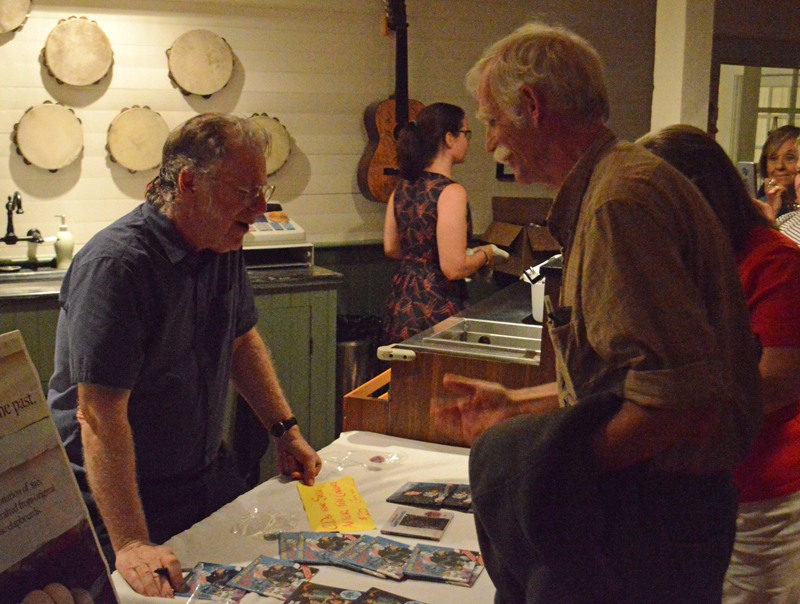 John Sebastian talks with fans and signs autographs after his performance at the Opera House at Boothbay Harbor on Thursday, July 25. (Evan Houk photo)