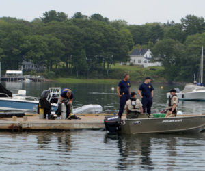 Maine Marine Patrol and Maine State Police personnel, including divers, prepare to continue the search for a Bremen man in Round Pond Harbor the morning of Tuesday, Aug. 13. (Evan Houk photo)