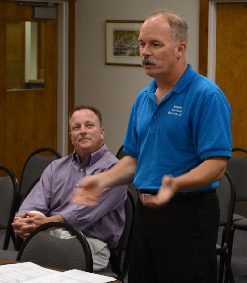 Brothers Matt (left) and Jim Murphy, of Murphy Appraisal Services Inc., meet with the Damariscotta Board of Selectmen on Aug. 21. The town recently contracted the firm to provide assessing services. (Evan Houk photo)