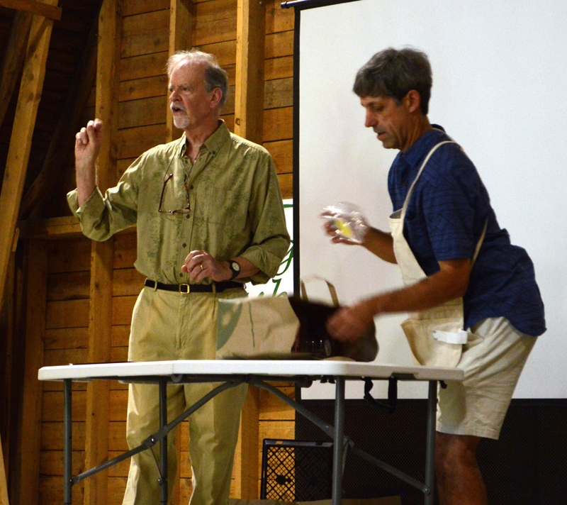 "Michael Uhl (left) and Mark Ward display various items and discuss whether they are recyclable during their ""Talking Trash!"" community forum at Darrows Barn in Damariscotta on Thursday, Aug. 22. (Evan Houk photo)"