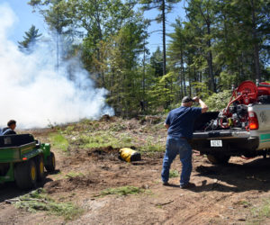 Firefighters use forestry equipment to respond to a woods fire on a logging road in Jefferson, Monday, Aug. 5. (Alexander Violo photo)