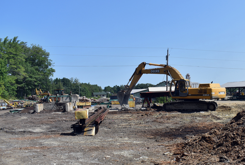 An excavator works at the site of the N.C. Hunt Lumber sawmill in Jefferson. The business is rebuilding after a devastating fire in March 2019. (Alexander Violo photo)
