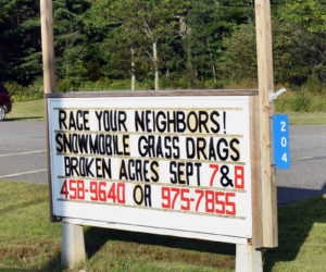"A sign at the Jefferson fire station advertises upcoming snowmobile ""grass drags"" at Broken Acres Family Retreat. The sport is growing in popularity, according to organizers. (Alexander Violo photo)"