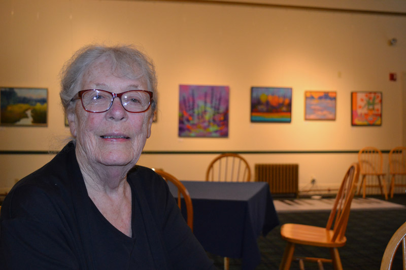 Southport artist June Elderkin chats about the work in her exhibit in the gallery at The Opera House at Boothbay Harbor on Thursday, Aug. 15. (Christine LaPado-Breglia photo)