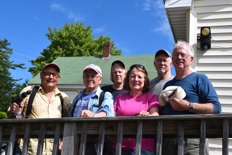 Chip Inc. volunteers stand on the ramp at Lincoln County Dental Inc. in Wiscasset on Friday, Aug. 23. From left: Dave Sellers, Gerry Brookes, Mal Briggs, Susan Lamb, C.R. Davis, and Tim Mellen. (Jessica Clifford photo)