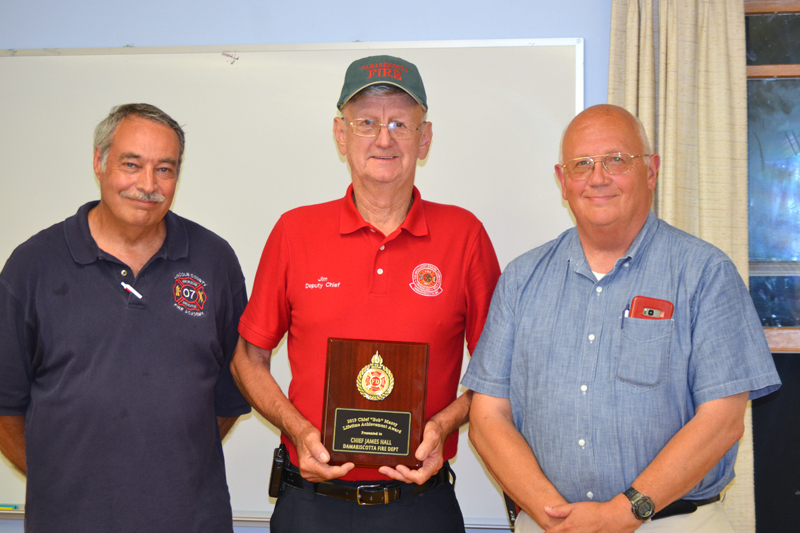 "Damariscotta Deputy Fire Chief James ""High Speed"" Hall accepts the Chief Bob Maxcy Lifetime Achievement Award from the Lincoln County Fire Chiefs Association as President Roger Whitney (left) and Vice President Paul Leeman Jr. look on. (J.W. Oliver photo)"