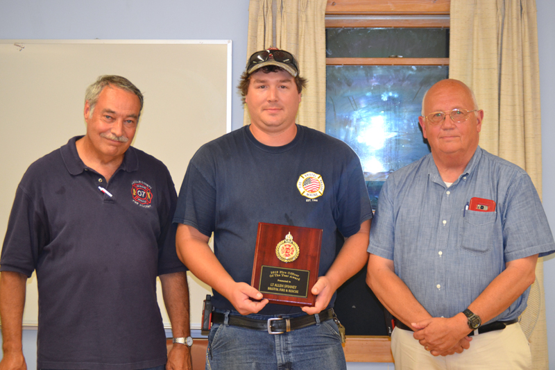 Lt. Allen Spinney, of the Bristol Fire Department, accepts the Officer of the Year Award from Lincoln County Fire Chiefs Association President Roger Whitney (left) and Vice President Paul Leeman Jr. (J.W. Oliver photo)