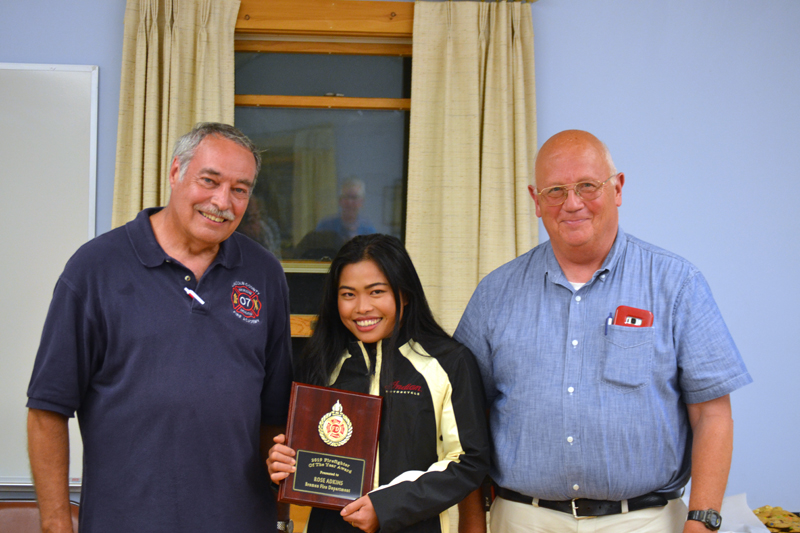 Rose Adkins, of the Bremen Fire Department, accepts the Firefighter of the Year Award, presented by Lincoln County Fire Chiefs Association President Roger Whitney (left) and Vice President Paul Leeman Jr. (J.W. Oliver photo)