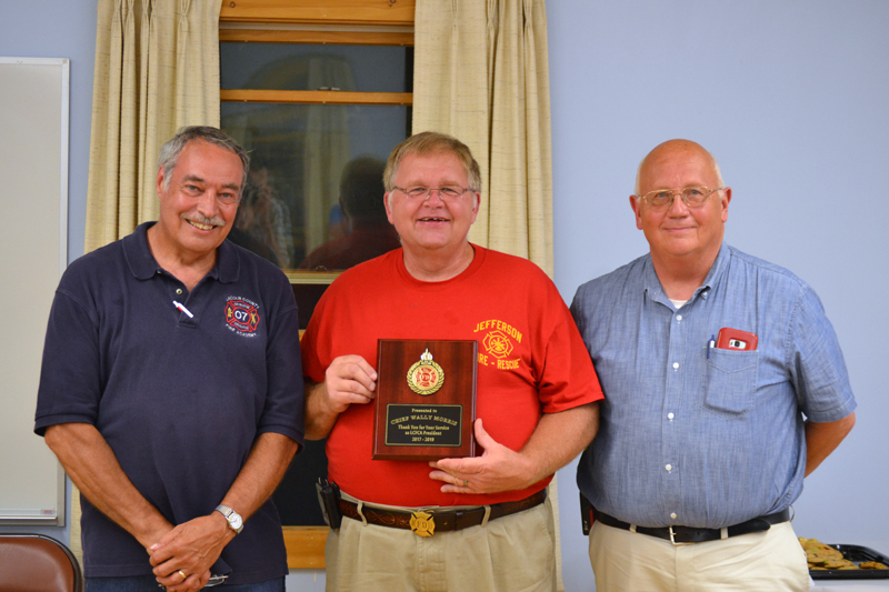 "Jefferson Fire Chief Walter ""Wally"" Morris accepts the Past President's Award from Lincoln County Fire Chiefs Association President Roger Whitney (left) and Vice President Paul Leeman Jr. (J.W. Oliver photo)"