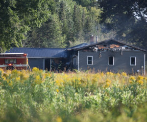 Fire damage is visible on a structure on Feylers Corner Road in Waldoboro the afternoon of Sunday, Aug. 25. (Jessica Clifford photo)