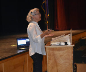 Colleen Coogan, a take reduction team coordinator with the National Oceanic and Atmospheric Administration, speaks at Medomak Valley High School in Waldoboro. (Alexander Violo photo)