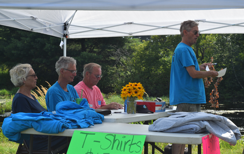Clary Lake Association Secretary George Fergusson addresses members at the annual meeting Sunday, Aug. 4, as association officers, from left, Mary Gingrow-Shaw, Malcolm Burson, and David Knight look on. (Jessica Clifford photo)
