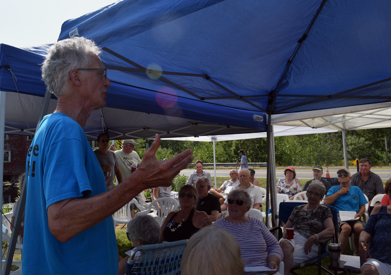 Former Clary Lake Association President Malcolm Burson speaks to members of the association the afternoon of Saturday, Aug. 3. (Jessica Clifford photo)