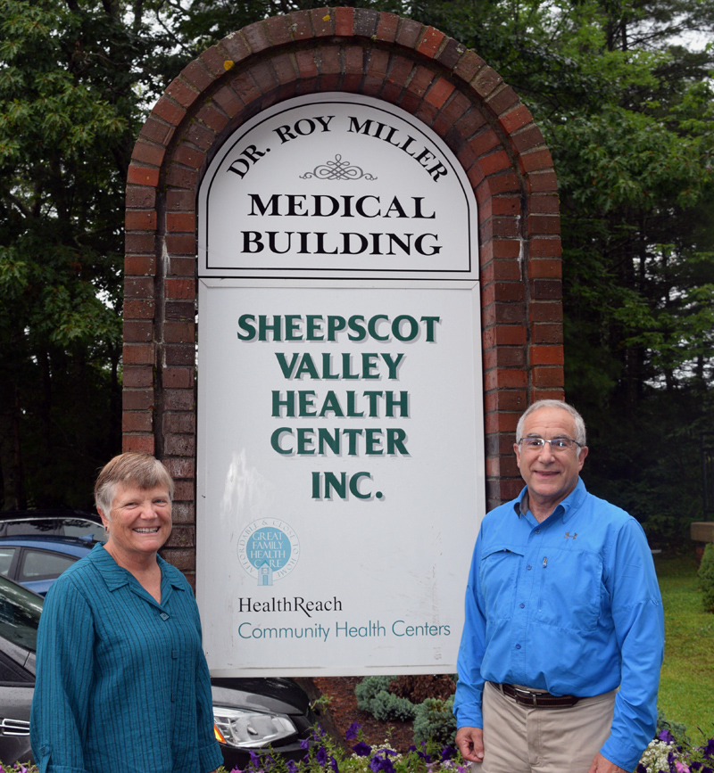 Lisa and Dr. Roy Miller stand next to the new sign for the Dr. Roy Miller Medical Building in Coopers Mills. The Sheepscot Valley Health Center Board of Directors renamed the building in honor of the center's first physician and his 38 years of service. (Jessica Clifford photo)
