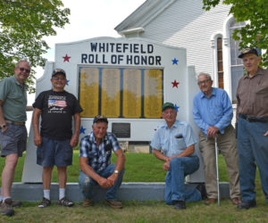 Members of the Whitefield senior men's group stand beside the Whitefield Roll of Honor, which members repaired in 2000 and again this summer. From left: Sandy Waters, Bob Gilman, Frank Small, Phil Russell, Albert Boynton, and Ken Chapman. (Jessica Clifford photo)