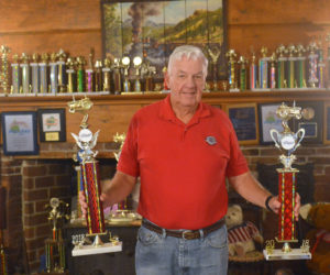 Jack Studley holds two 2018 point series championship trophies. The mantel of Jack and Grayce's 1791 Hall House in Nobleboro is loaded with trophies he has won pulling tractors at Maine fairs. (Paula Roberts photo)