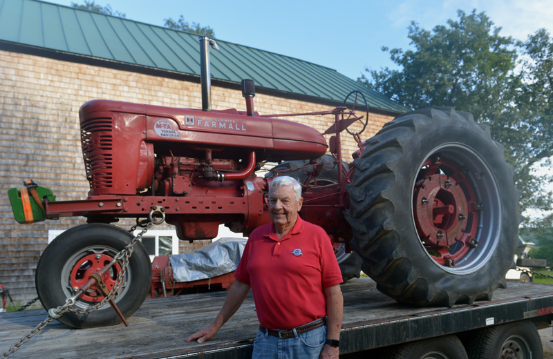 Jack Studley, of Nobleboro, with his 1954 International Super M-TA Torque Amplifier stock pulling tractor. (Paula Roberts photo)