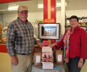 "Borealis Breads owner Jim Amaral, of Alna, and food writer Cynthia Finnemore Simonds, of Newcastle, display their new book, ""Borealis Breads: 75 Recipes for Breads, Soups, Sides, and More,"" at Borealis Breads in Waldoboro. (Jessica Clifford photo)"
