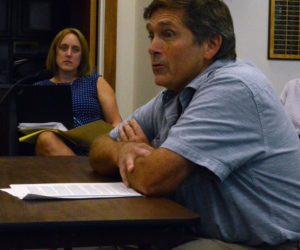 Damariscotta resident Buzz Pinkham, owner of Pinkham's Plantation and a licensed medical marijuana caregiver, addresses the Damariscotta Board of Selectmen during a public hearing on draft ordinances for marijuana businesses Aug. 28 as town attorney Amanda Meader looks on. (Evan Houk photo)