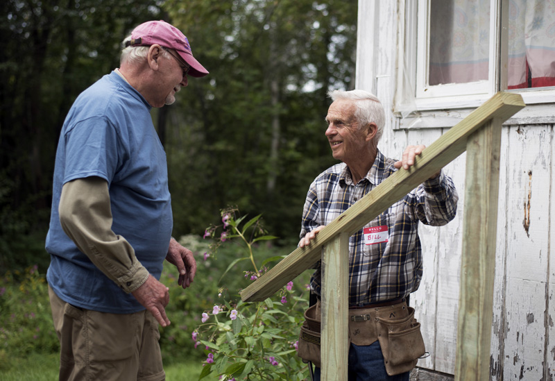Stephen Busch (left) and Bill Schwanemann discuss how to install a railing on a new set of stairs at Skyview Ridge Mobile Home Park in Waldoboro on Community Cares Day, Sunday, Sept. 8. (Jessica Picard photo)