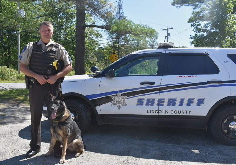 Lincoln County Sheriff's Office Sgt. Kevin Dennison and Duke stand next to their cruiser. Dennison was promoted to patrol sergeant in June. (Jessica Clifford photo)
