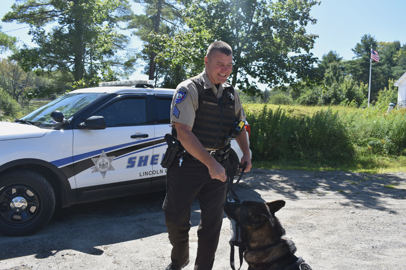Sgt. Kevin Dennison rewards his K-9 partner, Duke, with a toy. (Jessica Clifford photo)