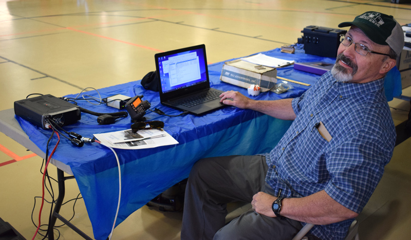 Karl Richards, of Lincoln County Amateur Radio, sends an email by amateur radio to his counterpart in a van in the Central Lincoln County YMCA parking lot. Lincoln County Amateur Radio was one of 34 organizations and vendors set up at the inaugural Lincoln County Emergency Preparedness Fair. (Evan Houk photo)