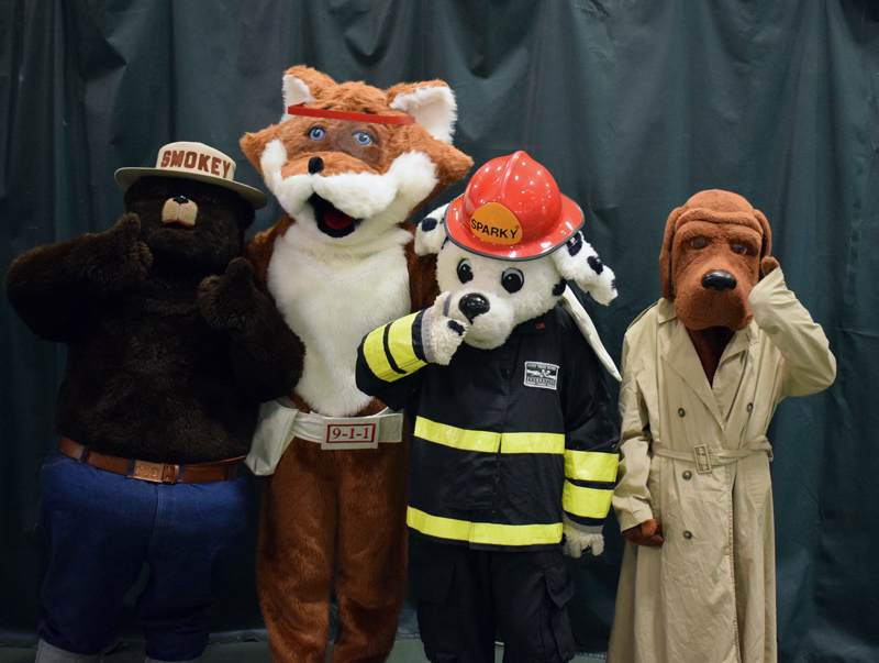 Emergency preparedness mascots Smokey Bear, Red E. Fox, Sparky the Fire Dog, and McGruff the Crime Dog pose for a photo at the Lincoln County Emergency Preparedness Fair. (Evan Houk photo)
