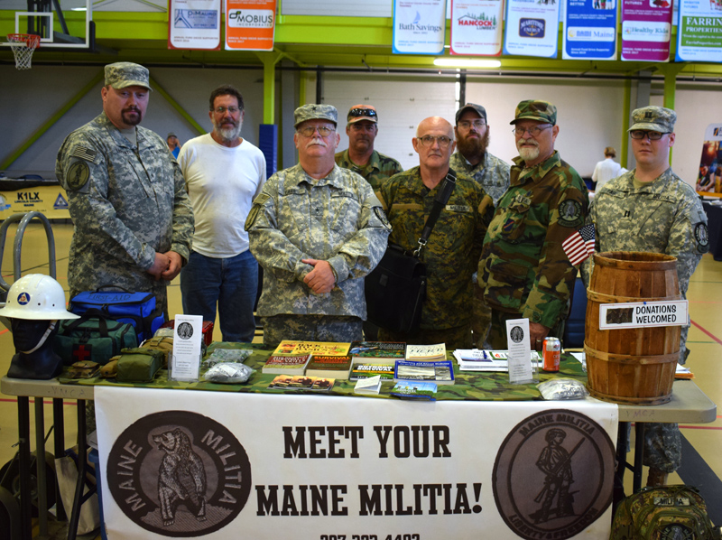 Maine Militia members with state coordinator Mack Page (third from left) attend the inaugural Lincoln County Emergency Preparedness Fair on Saturday, Sept. 21. The militia's pamphlet states that one of its goals is to be ready to respond in case of a natural disaster. (Evan Houk photo)