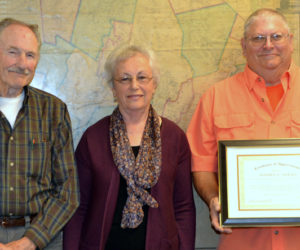 From left: Daniel Davey, Laurinda Cushman, and Jeffrey Sewall at the Lincoln County Board of Commissioners meeting Tuesday, Sept. 17. Daniel Davey and Cushman are the brother and widow of Lincoln County Sheriff's Office Detective Sgt. Donald Davey, who died in a crash while on duty July 30, 1984. Sewall, a former sheriff's deputy, responded to the crash. (Charlotte Boynton photo)