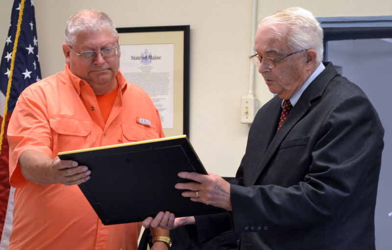 Former Lincoln County Sheriff's Deputy Jeffrey Sewall accepts a certificate of appreciation from Lincoln County Commissioner William Blodgett at the county courthouse Tuesday, Sept. 17. (Charlotte Boynton photo)