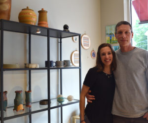 Midcoast Craft owners Heather and Dennis Chouinard stand next to a display of ceramics in their new gallery and shop in downtown Wiscasset. (Jessica Clifford photo)