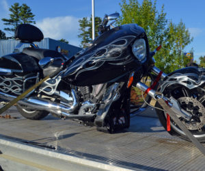 A 2003 Victory Cross Country motorcycle is towed from 695 Bath Road, Wiscasset, after a collision with a Subaru Impreza on Route 1 the afternoon of Sunday, Sept. 15. (Evan Houk photo)