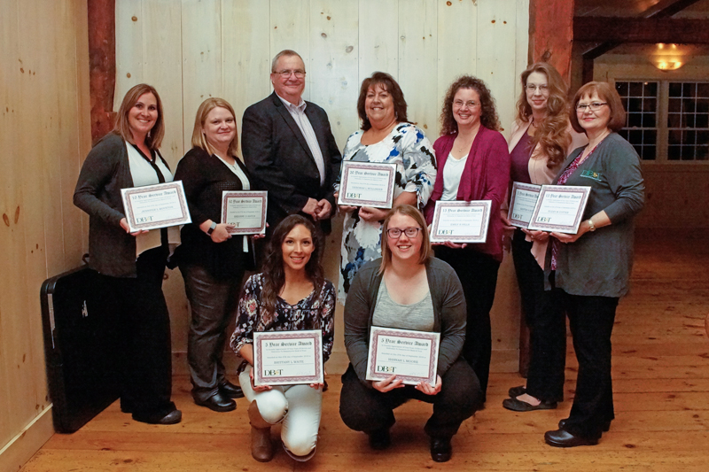 Damariscotta Bank & Trust's employees with certificates of recognition for their 5, 10, and 15 years of service at the annual Employee Recognition Night.